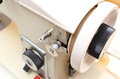 Metal spool of thread with sewing machine and part Stock Photo