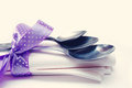 Metal spoons on a napkin with lilac a lentoyna a light background Royalty Free Stock Photo