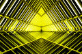 Metal structure similar to spaceship interior in yellow light. Royalty Free Stock Photo