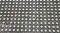 Metal studded flooring with one missing piece Royalty Free Stock Photo