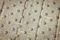 Metal studs metallic in concrete at a pedestrian crossing Royalty Free Stock Photography