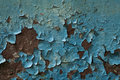 Metal surface covered with old blue paint, background Royalty Free Stock Photo