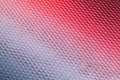 Metal surface with diamond pattern and red reflections Royalty Free Stock Photos