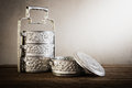 Metal Tiffin carrier, thai food carrier on wooden table backgrou Royalty Free Stock Photo