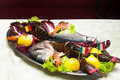 Metal tray of fish and crustaceans, lobster, sea bass, sea beam Royalty Free Stock Photo