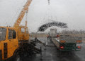 Metal unloading of fences crane it is rainy a view from the window Stock Photography