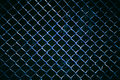 Metal wire fence or cage with blur background. Royalty Free Stock Photo