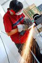 Metal worker with grinder Royalty Free Stock Image