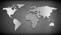 Metal world map on grate comb Royalty Free Stock Photo