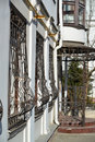 Metal wrought iron bars on windows of apartment house the an Royalty Free Stock Image