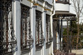 Metal wrought iron bars on windows of apartment house the an Royalty Free Stock Photo