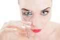 Metalic eyelash curler woman using on white background Stock Images