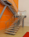 Metall stair with orange wall Stock Photos