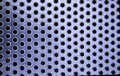 Metallic background with holes Royalty Free Stock Photo