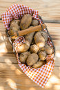 Metallic basket full of fresh new potatoes Royalty Free Stock Photo