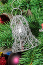 Metallic bell Christmas ornament tree, detail, close up Royalty Free Stock Photo