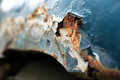 Metallic corrosion closeup of old car side panel with spot Royalty Free Stock Photo