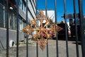 Metallic emblem on the lattice fence. Royalty Free Stock Photo