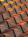 Metallic geometric cladding or panels in copper and gold colours Royalty Free Stock Photo