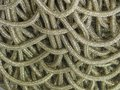 Metallic gold matted intertwined intertwined background Royalty Free Stock Photo