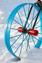 Metallic painted detail in the form of a bicycle wheel in the snowdrift in winter season outside Stock Photos