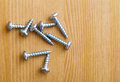 Metallic screws on the floor Stock Image