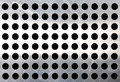 Metallic surface with holes Stock Photos