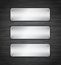 Metallic tablets attached with screws blank banners on brushed metallic wall vector illustration Royalty Free Stock Images