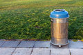 Metallic trash bin on park Stock Photos