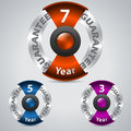 Metallic warranty badges with color ribbons seven five three year Royalty Free Stock Photos