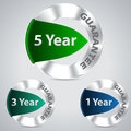 Metallic warranty badges five three and one year Stock Image