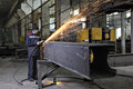 Metalworkers polishing welds metal structures producing fountai st petersburg russia may the plant produces worker in safety Royalty Free Stock Image
