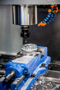 Metalworking cnc milling machine cutting metal modern processing technology small depth of field warning authentic shooting in Royalty Free Stock Image