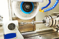 Metalworking polishing process industry and finishing grinding machine with metal cogwheel gera in workshop Stock Photo