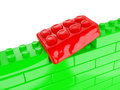 A metaphorical image of obesity the wall green toy building blocks with one element that does not fit Royalty Free Stock Photography