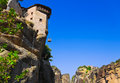 Meteora monastery and lifting cage in greece travel background Royalty Free Stock Image