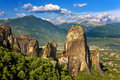 Meteora the rousanou monastery greece incredible sandstone rock formations rise from ground and monasteries on top of rocks holly Stock Images