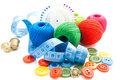 Meter plastic buttons thimbles and thread on white Royalty Free Stock Photography