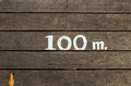 Meters hundred on the wooden bridge Royalty Free Stock Photography