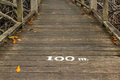 Meters last one hundred on the wooden bridge Royalty Free Stock Images