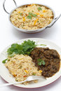 Methi lamb meal with tomato rice gosht or fenugreek served thakkali biryani and a leafy salad a kadai of the behind Stock Photography