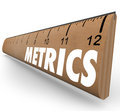 Metrics word ruler measurement system methodology benchmarking on a wooden to illustrate a set of measurements and tools to Stock Photos