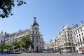 Metropolis building situated on representative gran via street september in madrid spain crossing the calle de alcala and Royalty Free Stock Photo