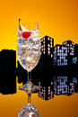 Metropolis gin tonic tom collins cocktail or in city skyline setting Royalty Free Stock Photo