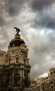 Metropolis in madrid storm clouds around the spain Stock Photos