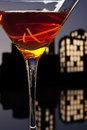 Metropolis manhattan cocktail in city skyline setting a is a made with whiskey sweet vermouth and bitters whiskeys used are rye Royalty Free Stock Image