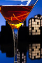 Metropolis manhattan cocktail in city skyline setting a is a made with whiskey sweet vermouth and bitters whiskeys used are rye Royalty Free Stock Images