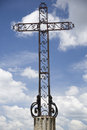 Mettalic cross and sky religous iron cloudy Royalty Free Stock Images