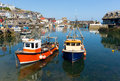 Mevagissey cornwall england boats in the harbour on a beautiful blue sky summer day Stock Image