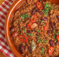 Mexican beef chilli con carne in terracotta dish Royalty Free Stock Image